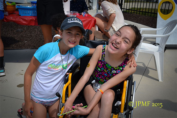 Girl in wheelchair with swim buddy