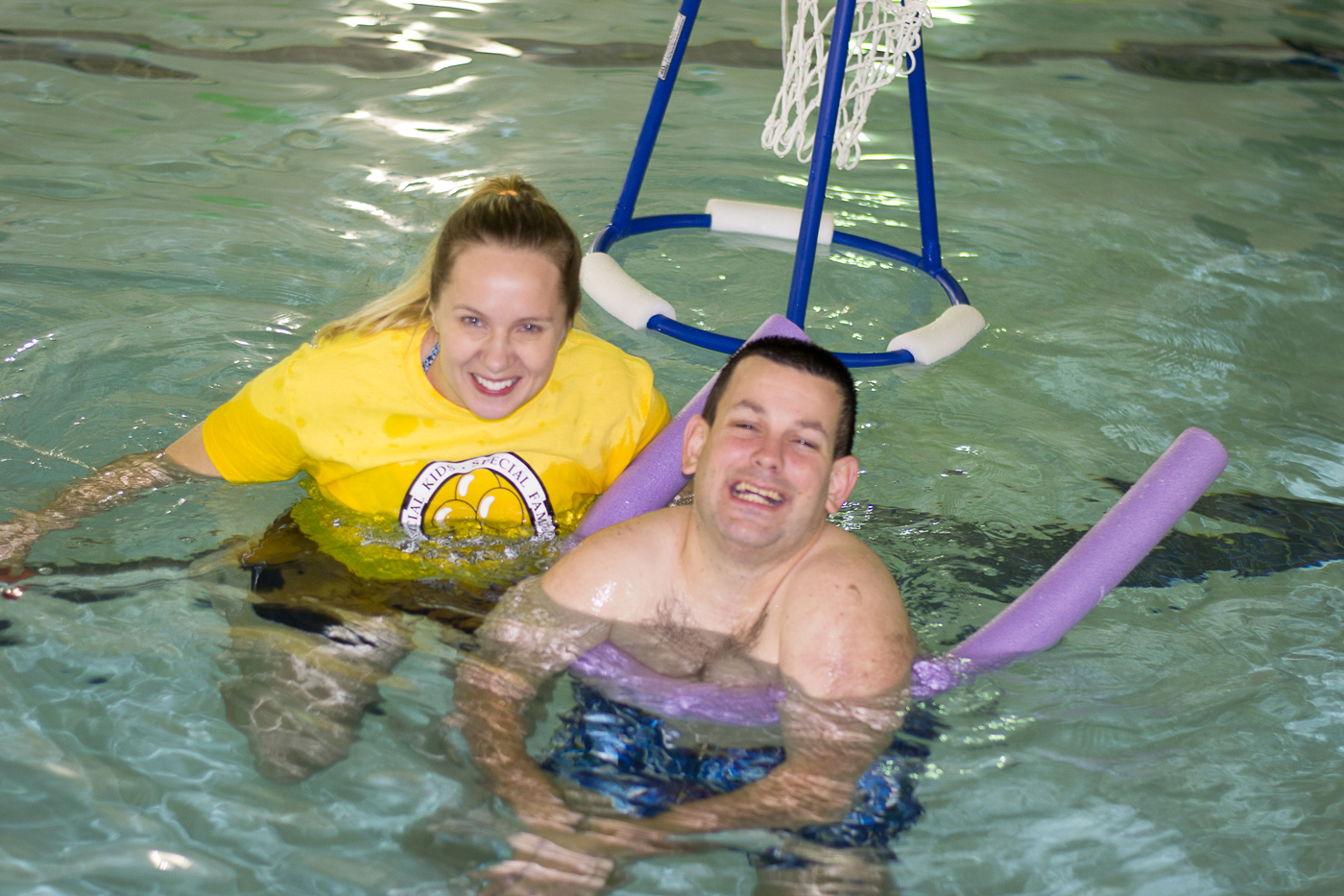 A JPMF volunteer swims with a child